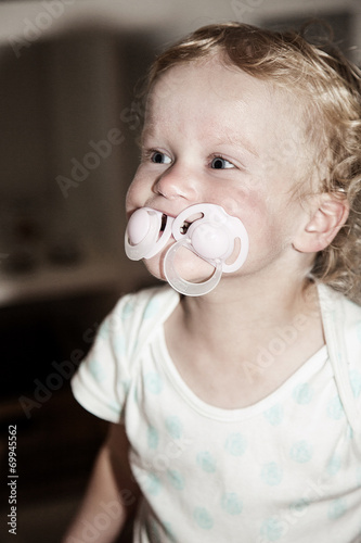 canvas print picture Toddler with two pacifier in her mouth