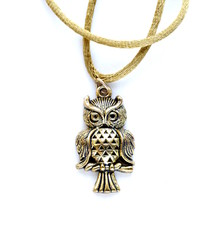 vintage gold pendant in the form of an owl