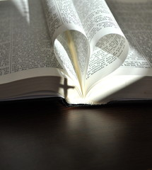 God is love, open book with heart shaped pages