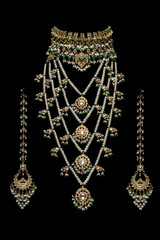 Close - up of gold and pearl necklace and earrings
