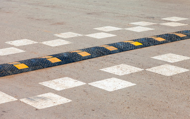 Traffic safety speed bump on an asphalt road