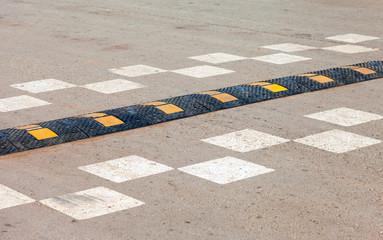 Traffic safety speed bump on an asphalt road
