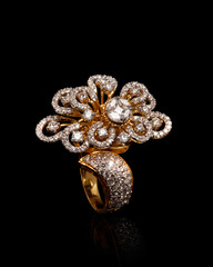 Close - up of gold and diamond ring