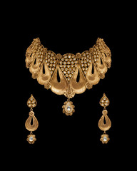 Close - up of gold and diamond necklace with earrings