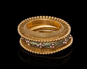 Close - up of designer golden bracelet