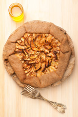 Galette with apples, nuts and honey. Apple pie.