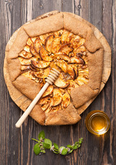 Galette with apples. Apple pie. Crostata.
