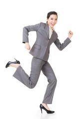 Happy running Asian businesswoman