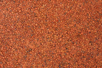 red laterite gravel for background.