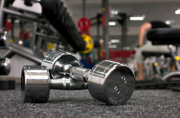 dumbbells in gymnasium