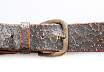 old vintage natural leather belt on white