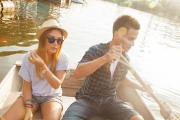 Couple Enjoying On A Boat