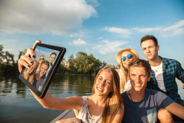 Cheerful Friends Taking Selfie On A Boat