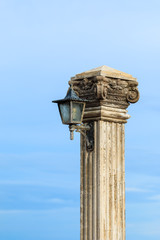 Old lamp post beside the sea