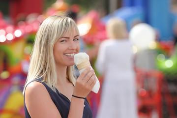 Girl with ice cream on the street