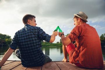 Two Young Men Enjoying Near River
