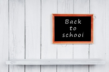 Back to school. Frame and wooden shelf.