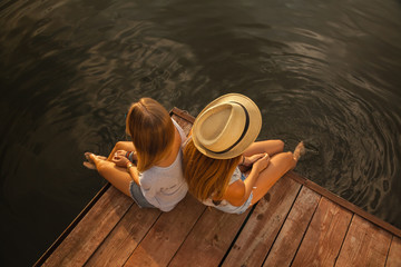 Two Girls Relaxing Near River