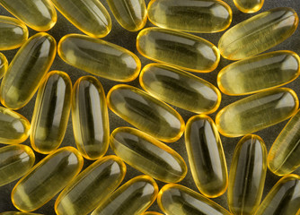 Close view of cod liver oil capsules