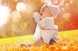 Leinwanddruck Bild - child sitting autumn