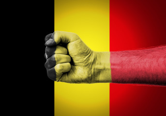 Flag Of Belgium Painted On A Man's Fist