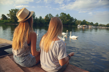 Two Girls Relaxing Near River