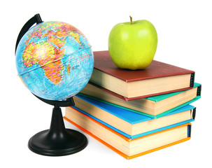 Books, an apple and globe. On white background.