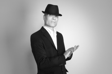 Man in suit and black hat