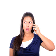 Beautiful woman talking on cellphone and being in shock of news