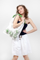 Beautiful woman holding a handbag.