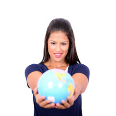 Portrait of beautiful young woman holding globe in hands against