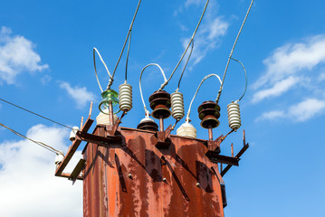 Power transformer against the blue sky background