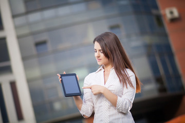 Happy business woman using a tablet computer