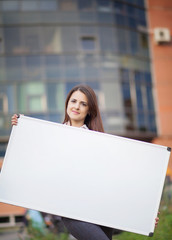 Business woman holding banner ad in her office