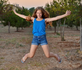 Portrait of a 12 year old girl jumping