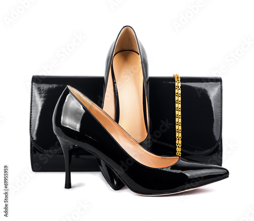 Beautiful  black shoes with clutches on white isolated backgroun - 69955959