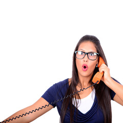 Portrait of young female in shock while talking on phone having
