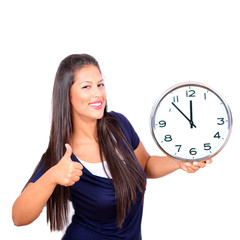 Portrait of beautiful young woman holding big clock with thumbs
