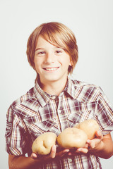 child with big potatoes