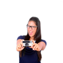 Young beautiful smiling woman holding retro vintage camera again