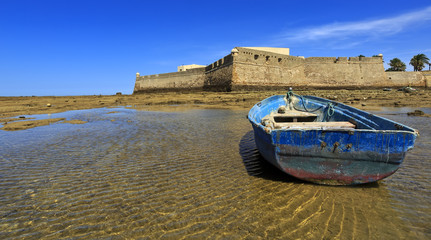 Castle of Santa Catalina with aged ship on forefront, Cadiz