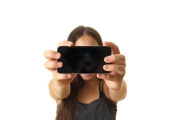 Teenage girl taking a selfie