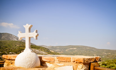 Orthodox cross and Mediterranean landscape