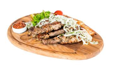 Healthy barbecued lean cubed pork kebabs served with