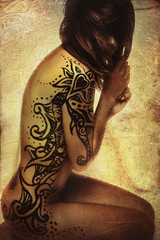 Latina with beautiful hand-painted tattoos on the skin