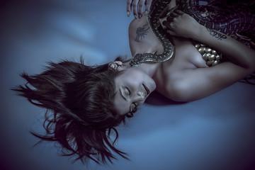 sensual beautiful latin woman with python snake