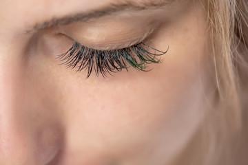 macro shot of female eye with false eyelashes