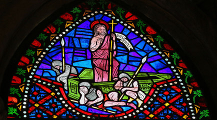 Jesus rising from his grave - stained glass