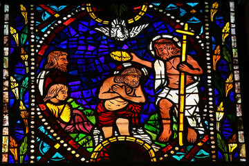 Baptism of Jesus by Saint John - stained glass in Leon