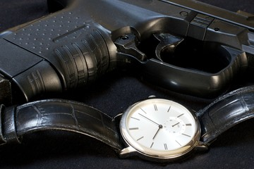 Watch and gun